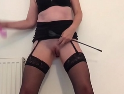 Standing squirt in stockings and a miniskirt