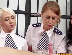 Female british cops tugging sub in his cell