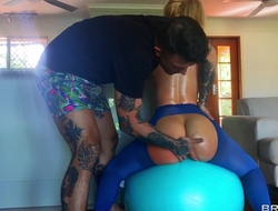 Big ass harlot gets oiled up and sodomized in the living room